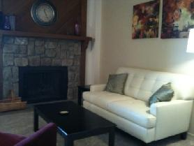 Cozy, Ground Floor Condo with Views. Perfect for curling up with a blanket and a cup of hot cocoa by the fire.