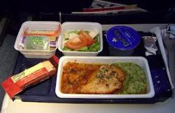 The Business Traveler's Guide to Surviving Long Flights: Stay Nourished and Hydrated - even if it means eating the airline meals.